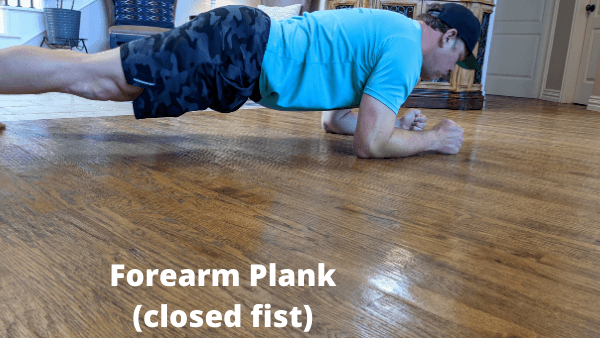 Best Core Exercises For Runners - Forearm Plank Closed Fist